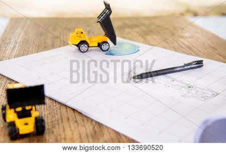 Business Construction drawings on blueprint architectural concept.Loader truck assembly simulation images..
