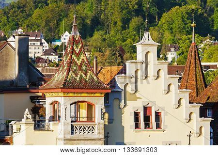 LUCERNE SWITZERLAND - MAY 05 2016: Colorful towers of historic buildings shown in the morning light in the City where history harmonizes with modern times and offers variety of tourist attractions