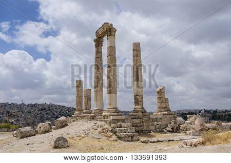 Ruins Of Roman Temple Of Hercules On The Amman Citadel With City View, Amman. Jordan