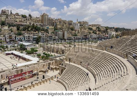 Amman, Jordan -May 28, 2016: Roman amphitheatre in downtown with Amman cityscape at background