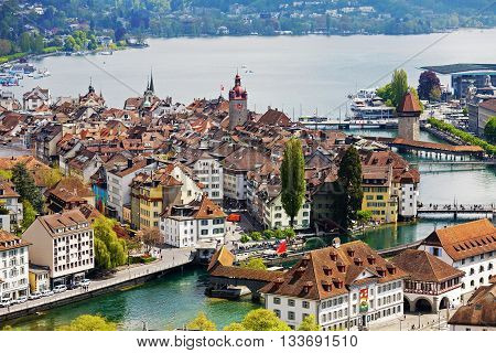 LUCERNE SWITZERLAND - MAY 04 2016: General view towards Old City. A variety of buildings shows unique character of the City which offers multitude of tourist attractions