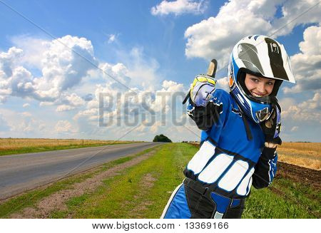 Success and victory!!! Attractive sexy woman in motoracer uniform.