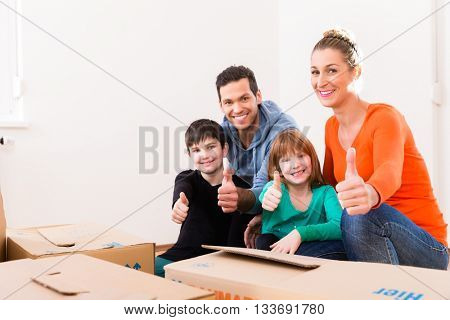 Family moving in new home or house showing thumbs up