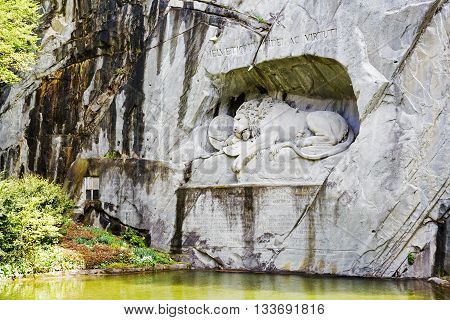 LUCERNE SWITZERLAND - MAY 04 2016: The monument of Dying Lion was carved in rock wall by the design of Danish artist Thorwaldsen. It is a World famous tourist attractions