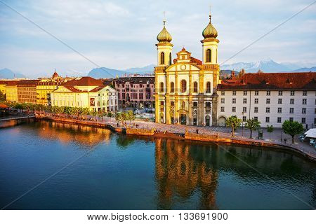 LUCERNE SWITZERLAND - MAY 02 2016: Evening view towards the Jesuit Church located by the Reuss river in old town. It is widely believed to be the most beautiful Baroque church in Switzerland