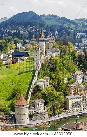 LUCERNE SWITZERLAND - MAY 04 2016: Towers of Lucerne's ancient city walls. These historic fortifications are called Musseg and are mostly very well preserved