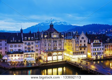 LUCERNE SWITZERLAND - MAY 03 2016: Night view towards buildings along the river Reuss shows unique character of Old Town and it looks to be very attractive for tourists visiting the city