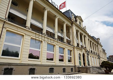 LUCERNE SWITZERLAND - MAY 03 2016: The classical building of The Grand Casino Luzern formerly Kursaal is located on famous lakeside promenade and is facing to lake Lucerne and was built in 1882