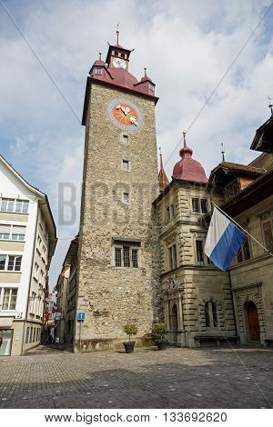 LUCERNE SWITZERLAND - MAY 02 2016: Clock tower it is a part Town Hall was built in the early 1600s it is impresive Renaissance building. The Clock Tower height it is over 40 meters