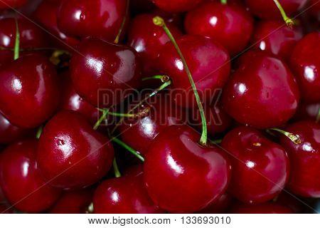 Ripe succulent sweet red cherries background macro