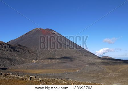 Mount Ngauruhoe, also known as Mount Doom from the Lord of the Rings films, as seen while trekking the Tongariro Alpine Crossing, New Zealand.