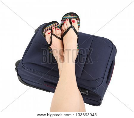 Legs lying on the blue suitcase