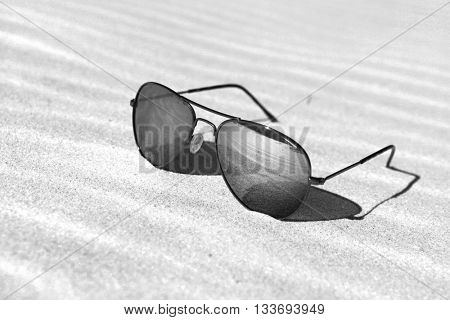 Reflecting sunglasses on the beach
