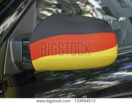 Outside mirror in black-red-and-gold the German national flag at the car of a soccer fan in Berlin Germany