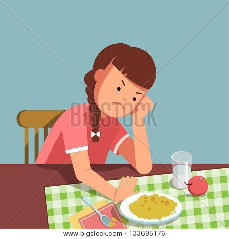 A little girl refusing food kid does not want to eat. The girl sits at the table and does not want to eating