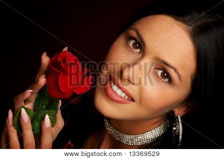 Pretty woman with rose