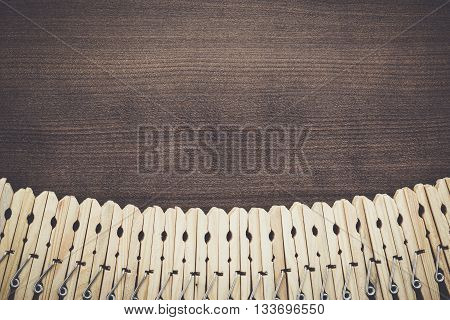 wooden clothes pegs on the brown table