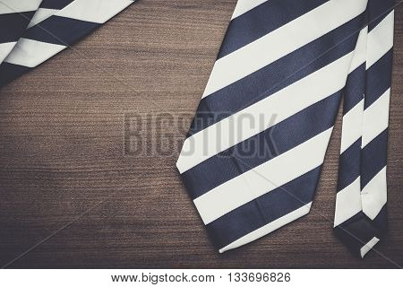 black and white striped necktie on the wooden table
