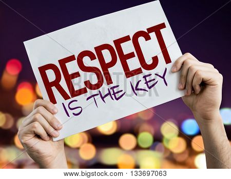 Respect Is The Key placard with night lights on background