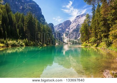 The Lake Braies with the Seekofel mountain in the background in the Dolomite Mountains Italy
