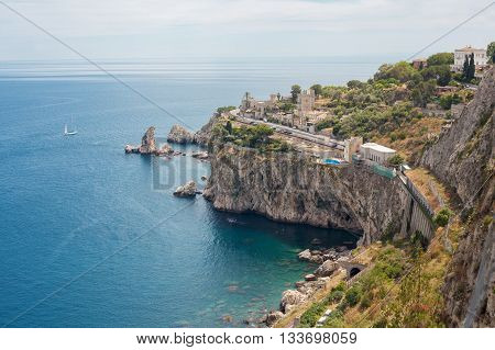 Taomina's coastline with cliff walls in Sicily Italy