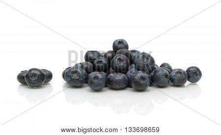 ripe blueberries on a white background with reflection. horizontal photo.