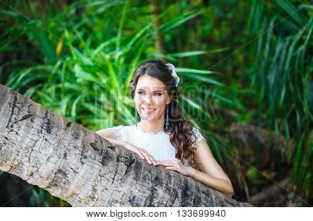 Close-up portrait young beautiful bride in a tropical jungle on a tropical island. Summer vacation concept.