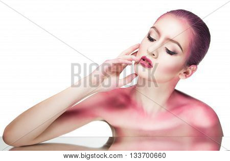 Topless model with bare shoulders covered with pink glitter.Isolated