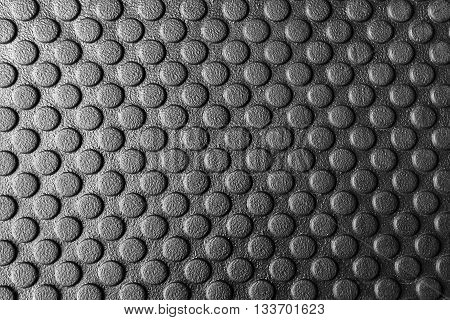 The rubber matsthe rubber mats with the round pattern texture for anti slip.The round pattern texture on the rubber mats.Close-up of rubber mats texture with round pattern in black and white scene.