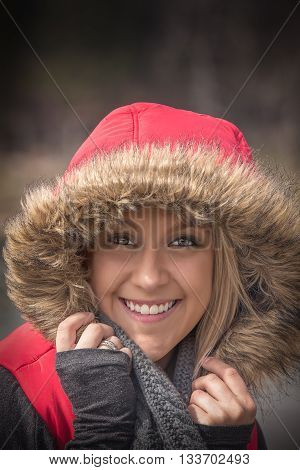Young woman with a red hood with fuzzy faux fur portrait