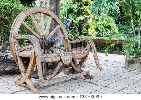 old wooden chair made of wood wheel