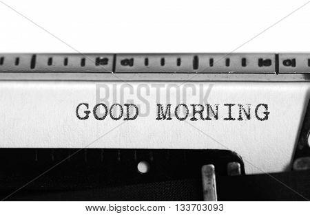 Typewriting on an old typewriter. Typing text: good morning