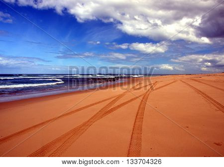 Tyre marks on an offroad driving seaside dune