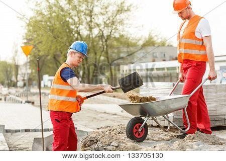 Men At Work Loading Barrow