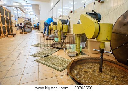 NIZWA, OMAN, MAY 27, 2016: production floor of Nizwa halwa factory