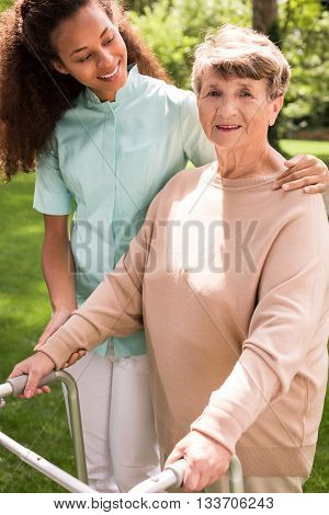 Helpful Caregiver With Senior