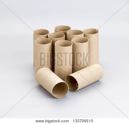 Pile of brown empty toilet tissue paper roll
