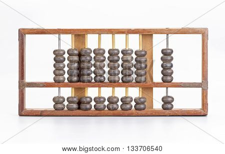 Antique wooden brown abacus on white background