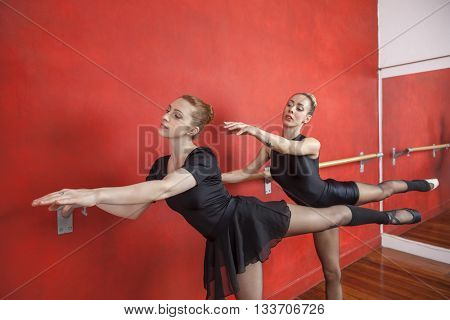 Ballerinas Performing At Barre In Rehearsal Room