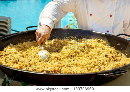Cooking Paella At An Outdoor Restaurant