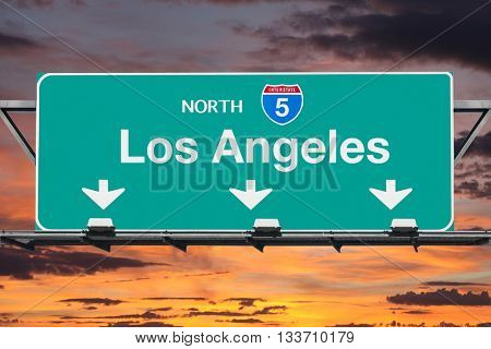 Los Angeles Interstate 5 north highway sign with sunrise sky.