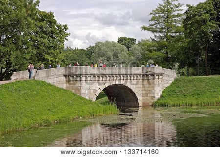 Gatchina Russia - 29 July 2015: Karpin bridge in the Gatchina Palace Park. Built in the 18th century