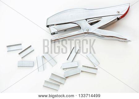 Staples And Stapler On White Background