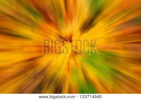 blurry abstract yellow green background texture with radial streaks
