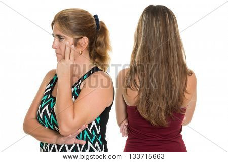 Sad and worried mother after having an argument with her teenage daughter - Isolated on a white background