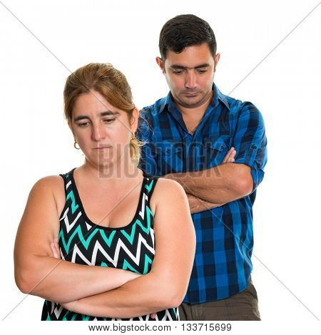 Couple conflict, Divorce - Sad woman with an out of focus serious man on the background