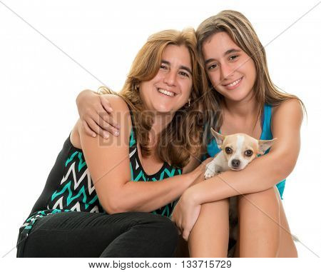 Teenage girl hugging her mother and their little chihuahua dog - Isolated on a white background