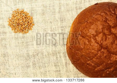 Concept. Bread and grains against the white linen tablecloths