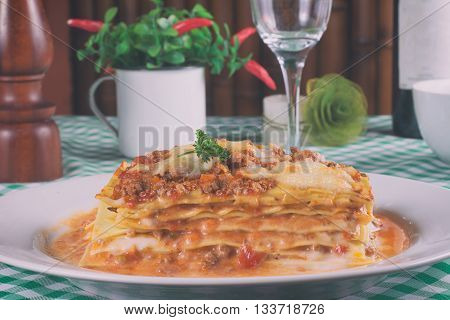 Traditional Italian Bolognese Lasagna over a table