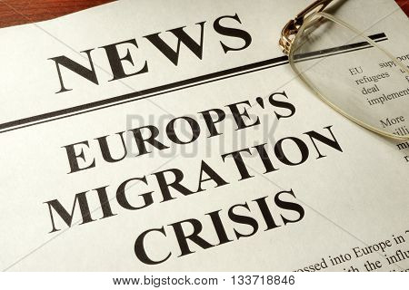 Newspaper with header news and Europe's migration crisis.